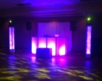 Xplosive setup with two lit towers and moving heads