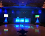 Twin flat screens with blue LED lit booth