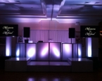 Wedding setup with staging and two flat sceens