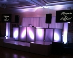 Wedding setup with twin screens and staging
