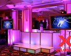 Wedding setup with White Framed TVs, staging, uplighting and two moving heads