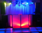 Tiered staging with six moving heads, pipe and drape back drop,and LED booth set at Temple B'nai Tikvah