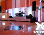 Tufted DJ booth with two tiered band staging
