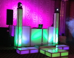Tall towers with moving heads, LED staging and LED booth